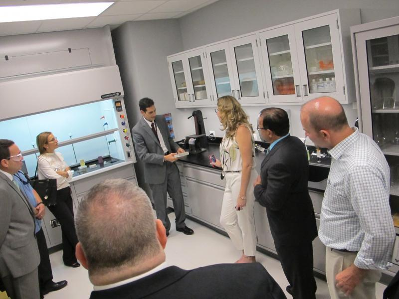 (Center) Jose Mendez, Director of the San Juan Laboratory provides a tour of the new facility.