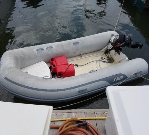 A dinghy is a small inflatable rubber boat.