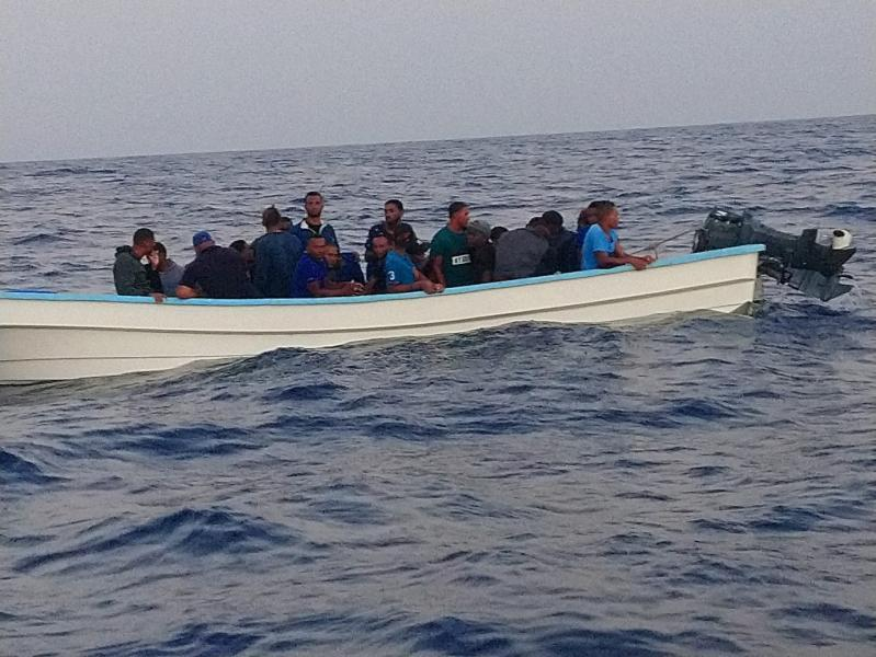 A pictur of the boat with 28 aliens near Aguadilla, Puerto Rico. Inside 42 pounds of cocaine were found.