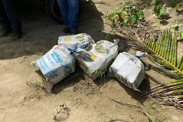 Bales of suspected narcotics as they were found on the beach.