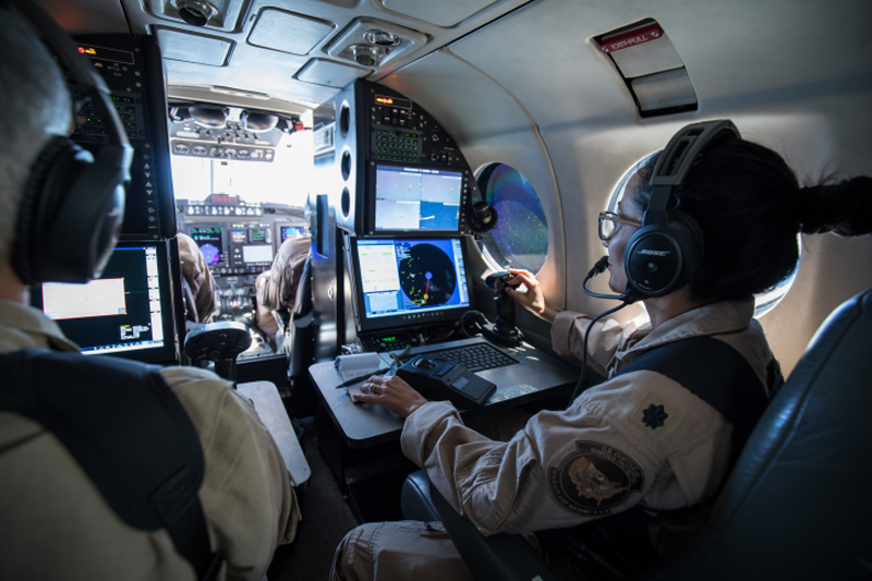 An Aviation Enforcement Agent operates airborne sensors on a Multi-Role Enforcement Aircraft.