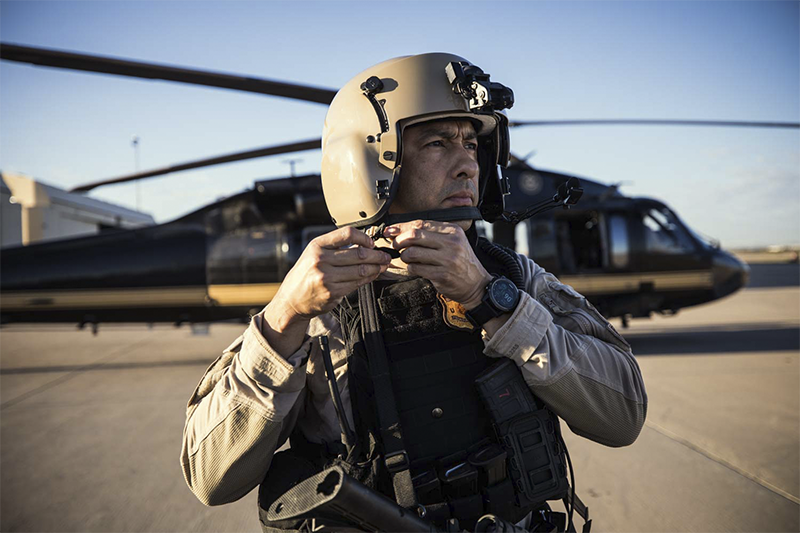 An Air and Marine Operations Aviation Enforcement Agent prepares for an airborne mission.