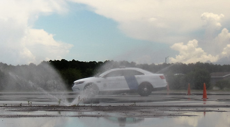 CBP Officer Trainee driving in a course to become equipped with the skills, techniques, operational awareness, and principles to complete Non-Emergency Vehicle Operations and skid control.
