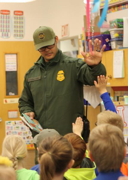 Border Patrol Agent Carrillo interacts with the preschoolers at the Lutheran Preschool in Havre.