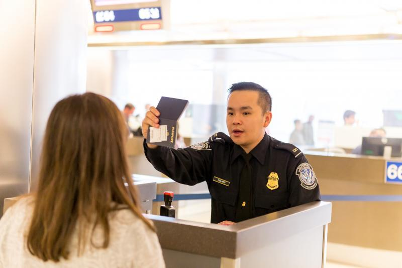 CBP officer conducting passenger processing functions at LAX