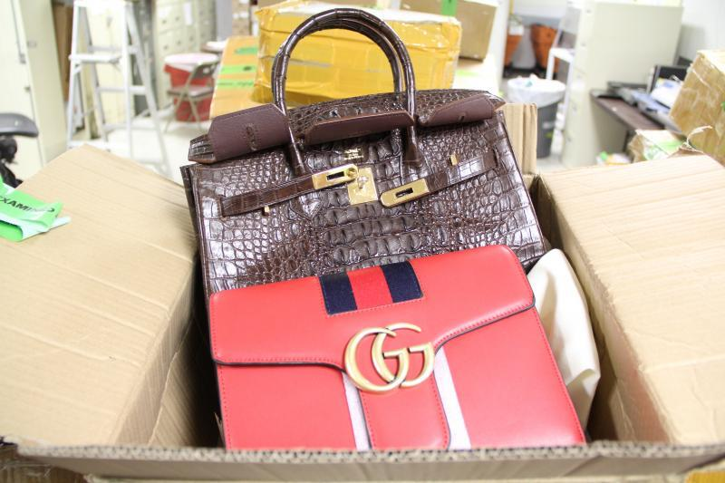 Counterfeit Gucci and Michael Kors purses were seized at O'Hare's International Mail Facility.