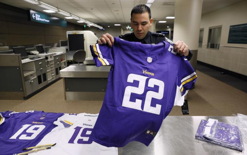 A CBP Officer displays a counterfeit NFL jersey seized as part of an enforcement operation during Super Bowl 52.