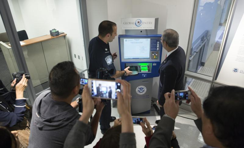 TECRO Representative Stanley Kao demonstrates a Global Entry kiosk.