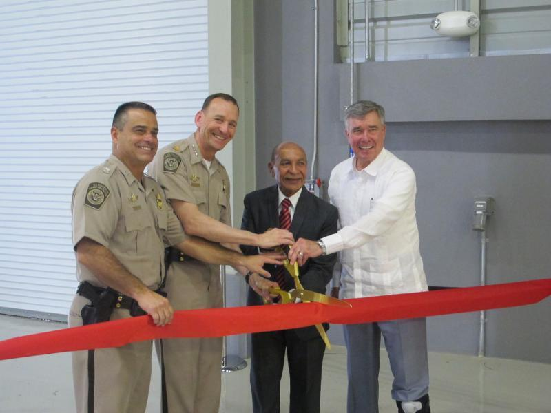 Cutting the ceremonial ribbon (from left to right); Johnny Morales, Director of Air Operations in the Caribbean; Randolf Alles, Executive Assistant Commissioner AMO; Carlos Mendez, Mayor of Aguadilla; and R. Gil Kerlikowske, CBP Commissioner.