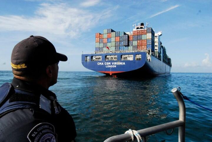 CBP officer observes a cargo ship docking in the United States.