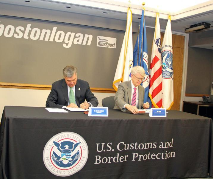 CBP Commissioner R. Gil Kerlikowske and Massport Chief Executive Officer Thomas Glynn sign the Reimbursable Services Agreement at Boston Logan International Airport.