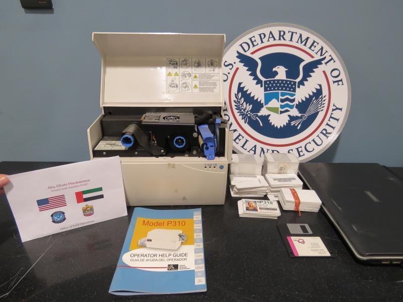 The seized laptop, printer, magicJack USB, floppy disc, hard drive, and blank driver's licenses with bar codes.