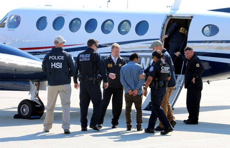 CBP & ICE turn over Guatemalan fugitive to MD lae enforcemnet at ATL airport