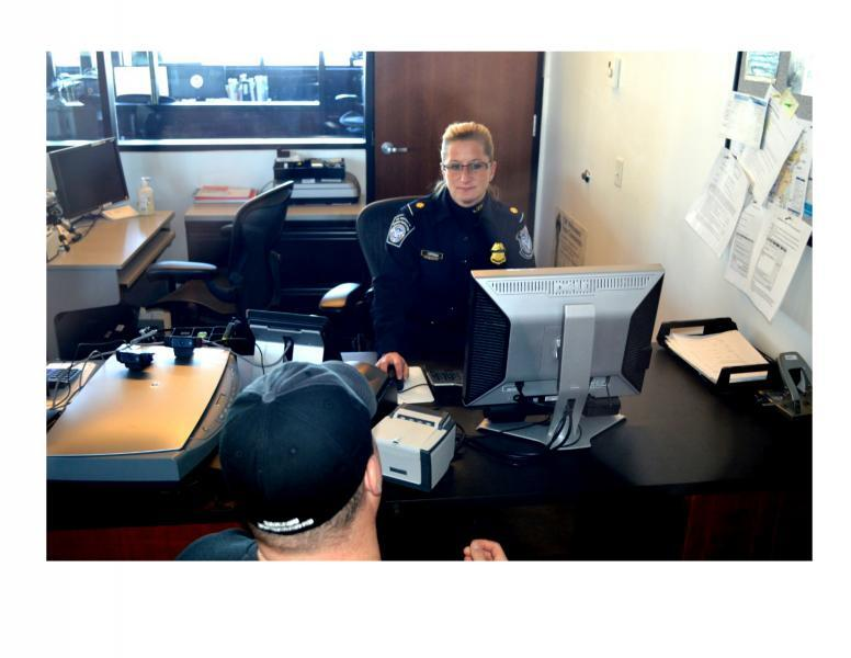 CBP officer proceessing trusted traveler application