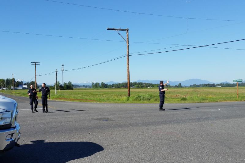 U.S. Customs and Border Protection officers direct traffic at a three-car accident May 1 in Lynden, Washington.