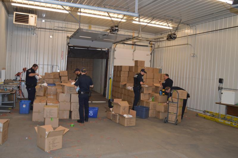 CBP officers unload a rail car that contains conterfeit merchandise at teh International Falls Port of Entry in Minnesota.