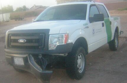 Damaged Border Patrol vehicle that was rammed by suspected human smuggler
