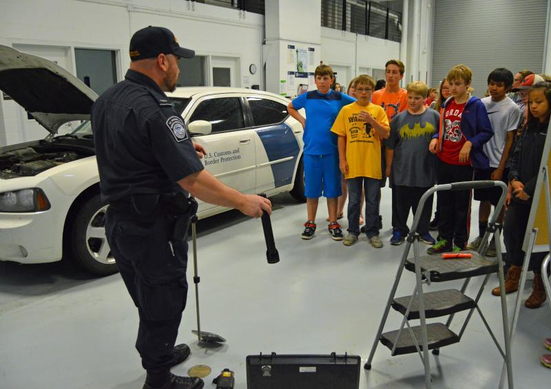 Customs and Border Protection Officer Joshua Paulson provides a demonstration to sixth graders at the Warroad Port of Entry on May 25.