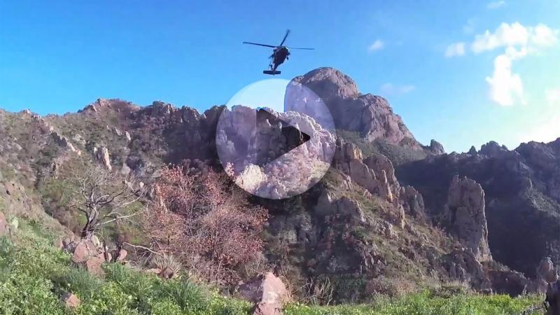 Tucson Sector agents & Tucson Air Branch personnel worked together to rescue a stranded migrant from the Baboquivari Peak personnel
