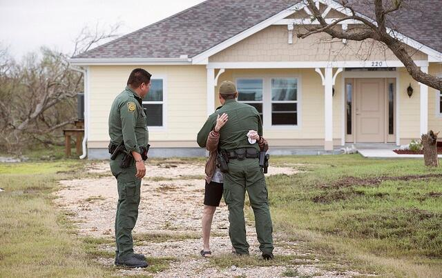 A grateful disaster survivor hugs a U.S. Border Patrol agent.  U.S. Border Patrol agents were part of U.S. Coast Guard emergency operation centers identifying disaster survivors in need of assistance.