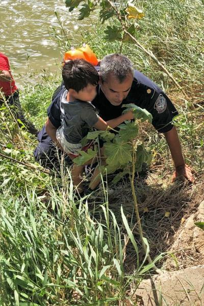 A Border Patrol agent examines a child's medical condition