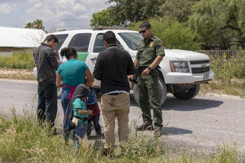Illegal aliens apprehended by a Border Patrol agent