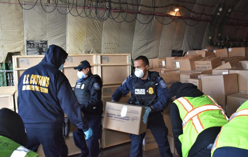 CBP officers inspect a shipment