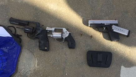 Three firearms recovered after being thrown into the ocean.