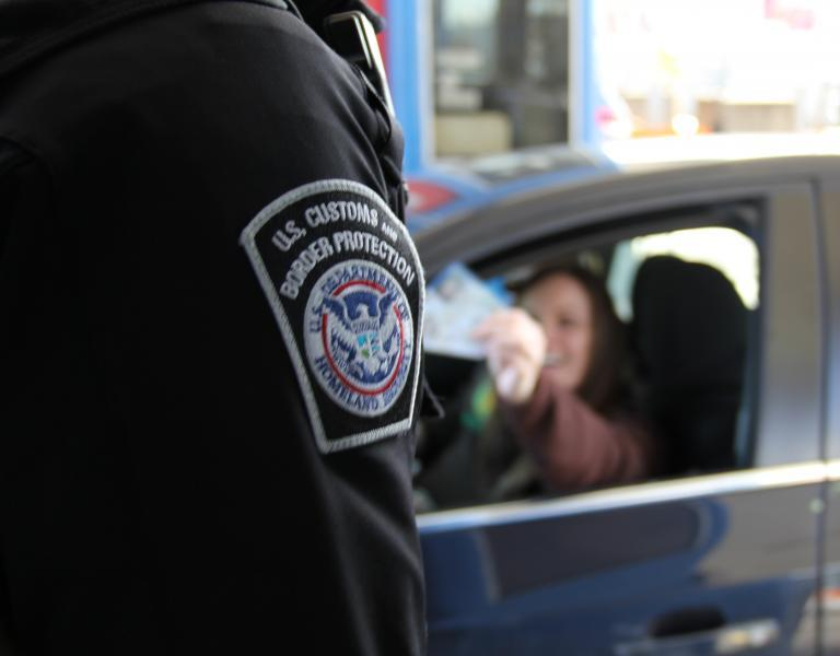 CBP offcer inspects travel documents