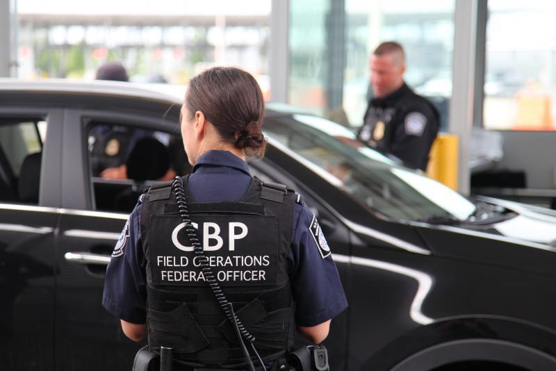 CBP officers inspecting arriving travelers