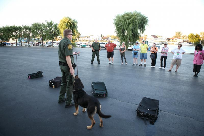 Border Patrol agent demonsrates capabilities of highly-trained canine.