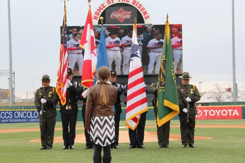 Delivering a flawless performance before an excited crowd,  CBP honor guard members paraded the colors as a middle-school student sang the Star Spangled Banner.