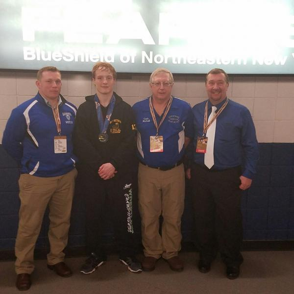 SCBPO Mitchell poses with Tanner LaPiene and school officials