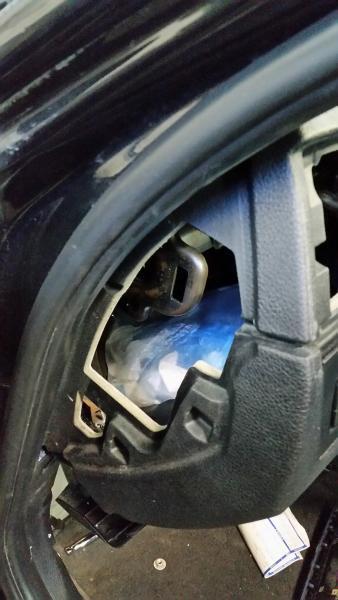 Illegal narcotics hidden behind car dashboard.