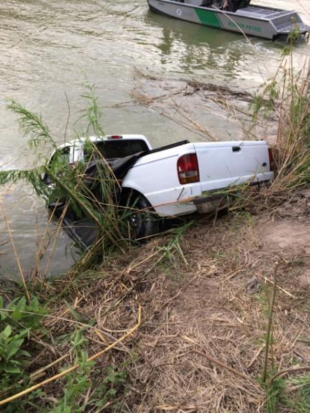 Drug laden vehicle after it splashes down in the Rio Grande