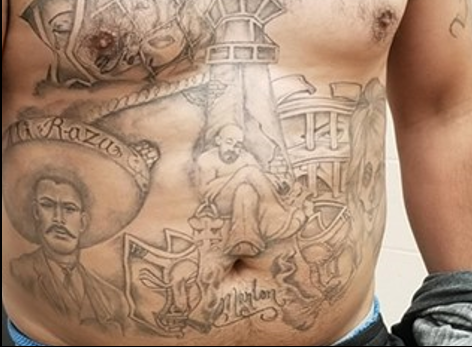 Chest of a gang member covered with gang affiliated tattoos