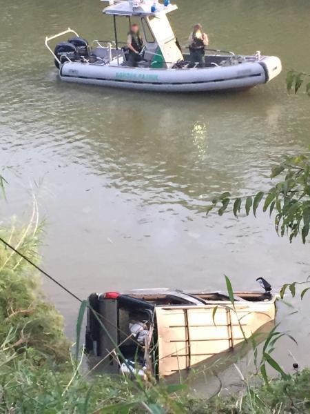 A local wrecker removes SUV from the Rio Grande