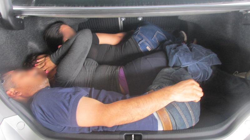 Immigrants discovered in thrunk of car