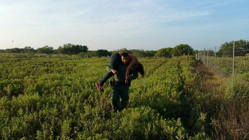 Border Patrol Agent transports abandoned female from ranchland