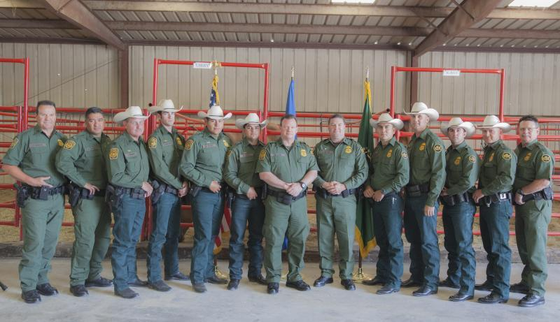 US Border Patrol Law Enforcement Operations Directorate Chief Scott A. Luck poses with new Horse Patrol graduates