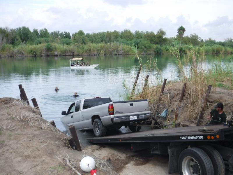 "Vehicle used in ""spalshdown"" being pulled out of the Rio Grande"