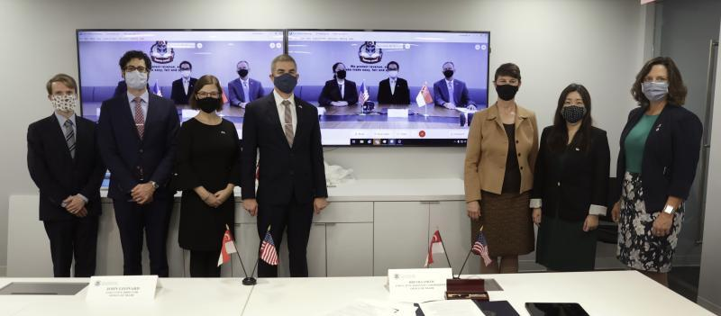 The U.S. and Singaporean negotiating teams pose for a photo after the virtual signing ceremony.