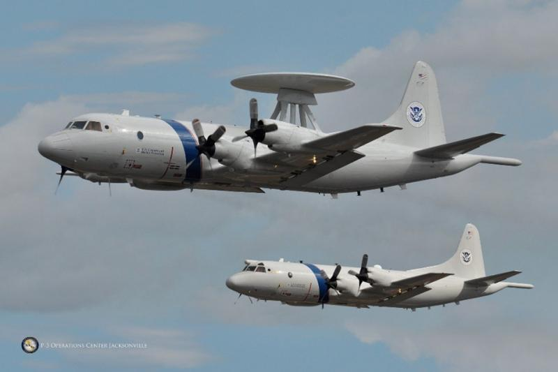 Photograph of a CBP P-3 Long Range Tracker aircraft in flight.