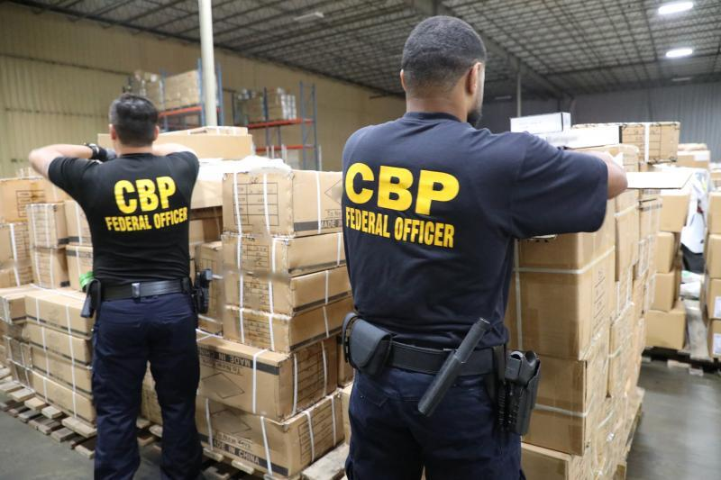 CBP personnel at the Port of New York/Newark inspect a shipment of Chinese hair products suspected to have been made with forced labor