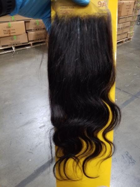 A CBP officer at the Port of New York/Newark displays a Chinese hair product suspected to have been made with forced labor