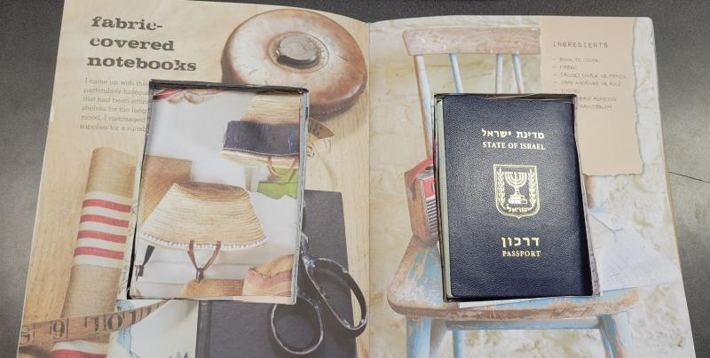 Hollowed out book with Israeli passport inside.