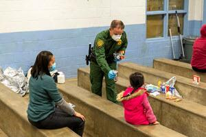 Border Patrol agents at Brown Field Station near San Diego use personal protective equipment and social distancing to protect themselves and the people they encounter from the coronavirus.