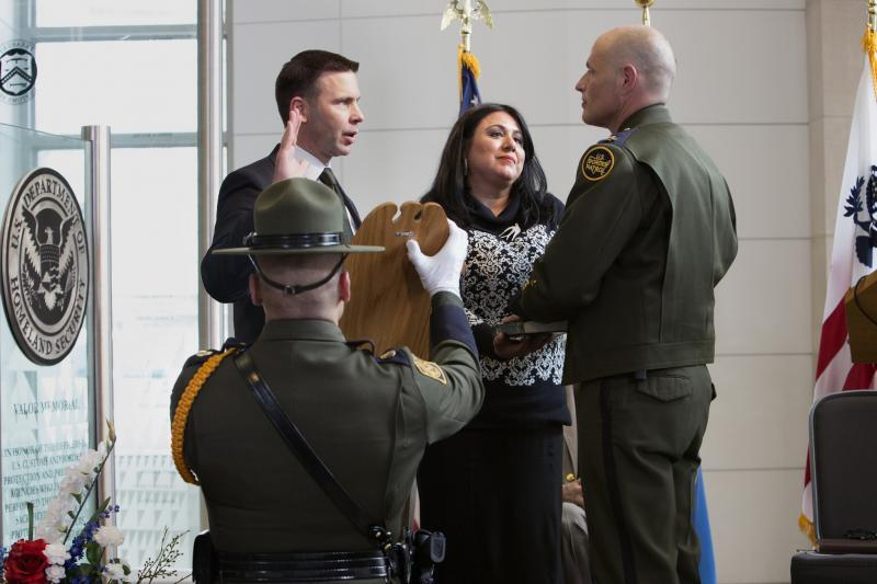 CBP Acting Commissioner Kevin McAleenan (left) administers the Oath of Office to Ronald Vitiello as the new chief of the Border Patrol. Chief Vitiello's wife, Nuri, looks on. Photo by Donna Burton
